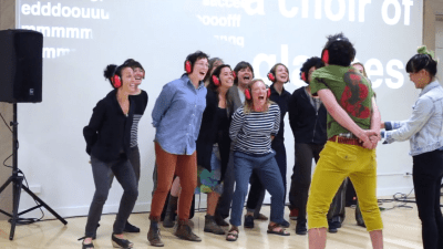 Image: Deaf artist using sound with a happy group of participants