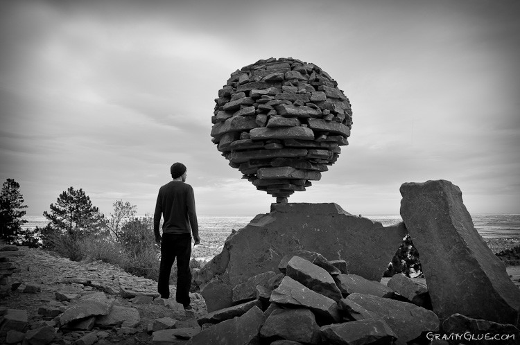 Image: flat rocks making a huge balancing ball of rock