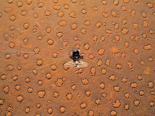 Image: Theo hangs above bizarre circular spots in the desert