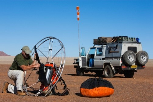 Image: Theo readying paraglider by Land cruiser