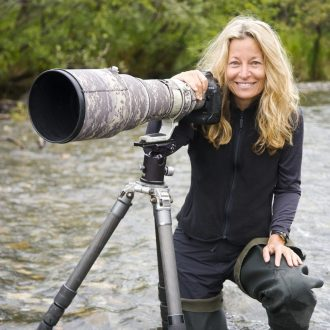 Image: Jami Tarris with a long lens on her camera