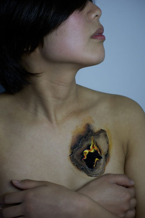 Image: It looks like a hole is burning in a woman's chest by Hikaru Cho