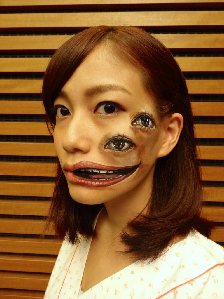 Image: Woman with double mouth and eyes on her face by Hikaru Cho