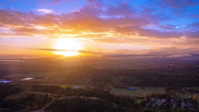 Image: Sun rising over landscape