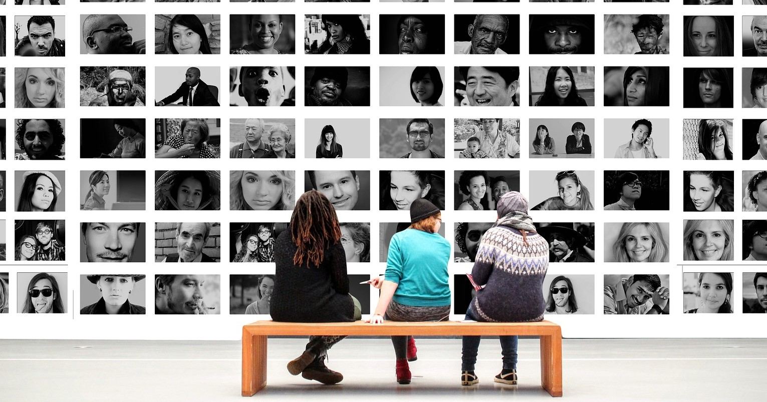 Image: Wall of black and white pics of humans making faces