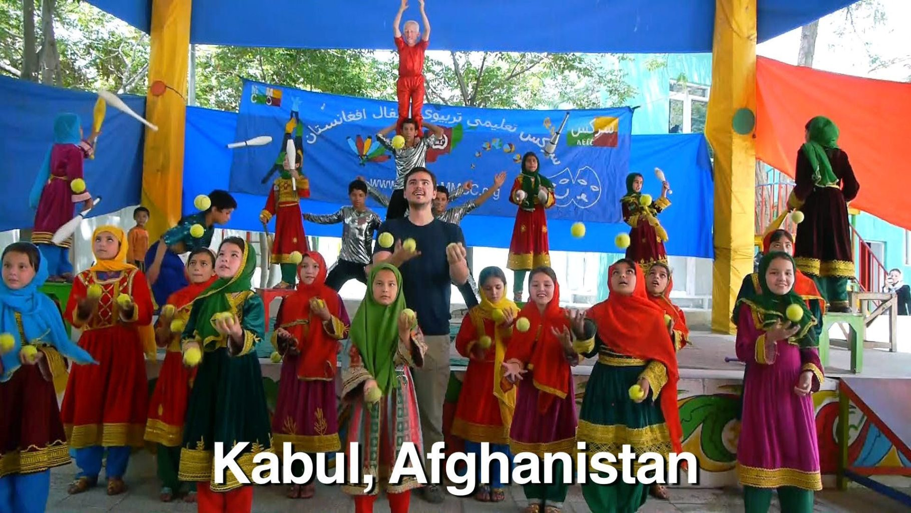 "Image: Matt Harding, head of ""Where the Heck is Matt?"", is dancing with young girls in Kabul Afghanisatan"