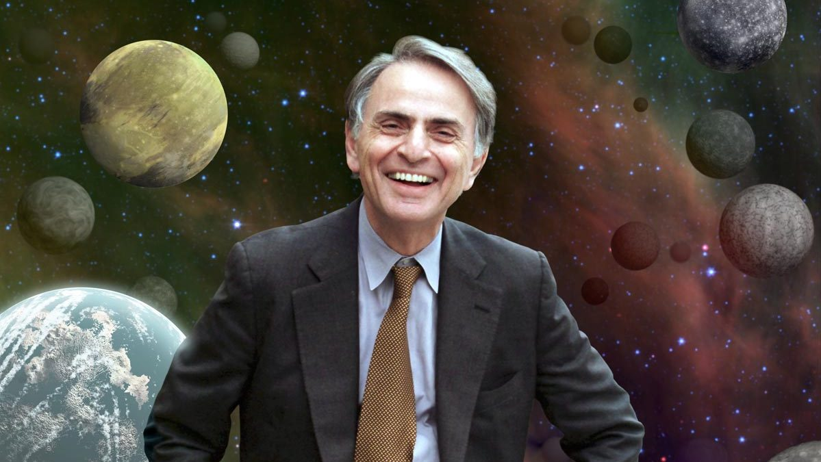 Image: Carl Sagan in front of an image of planets. Insights from Carl Sagan.