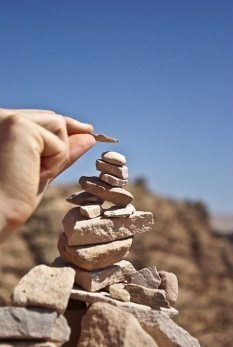 Image: stacking a small rock cairn