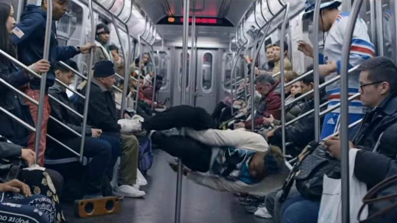 Image: Acrobatic dancing on a subway in NYC