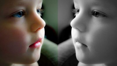 Image: Mirror image of a little girl, one color and one black and white