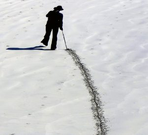 Image: man putting a line in the sand with a stick. It's a fine line between objection and rejection.