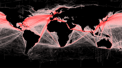 Image: A black map of the globe with thousands of red lines connecting countries