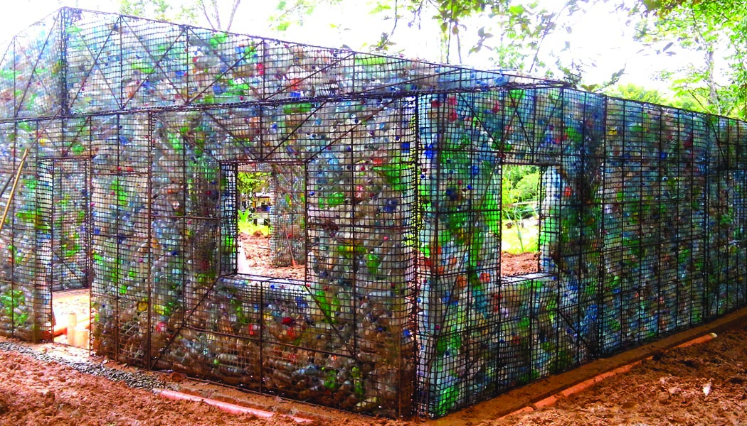Image: Great people have filled metal cages with plastic bottles to create the framework of the houses.