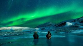 Image: people talking under the northern lights