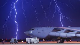 Image: Lightning strikes an airplane and a ground vehicle