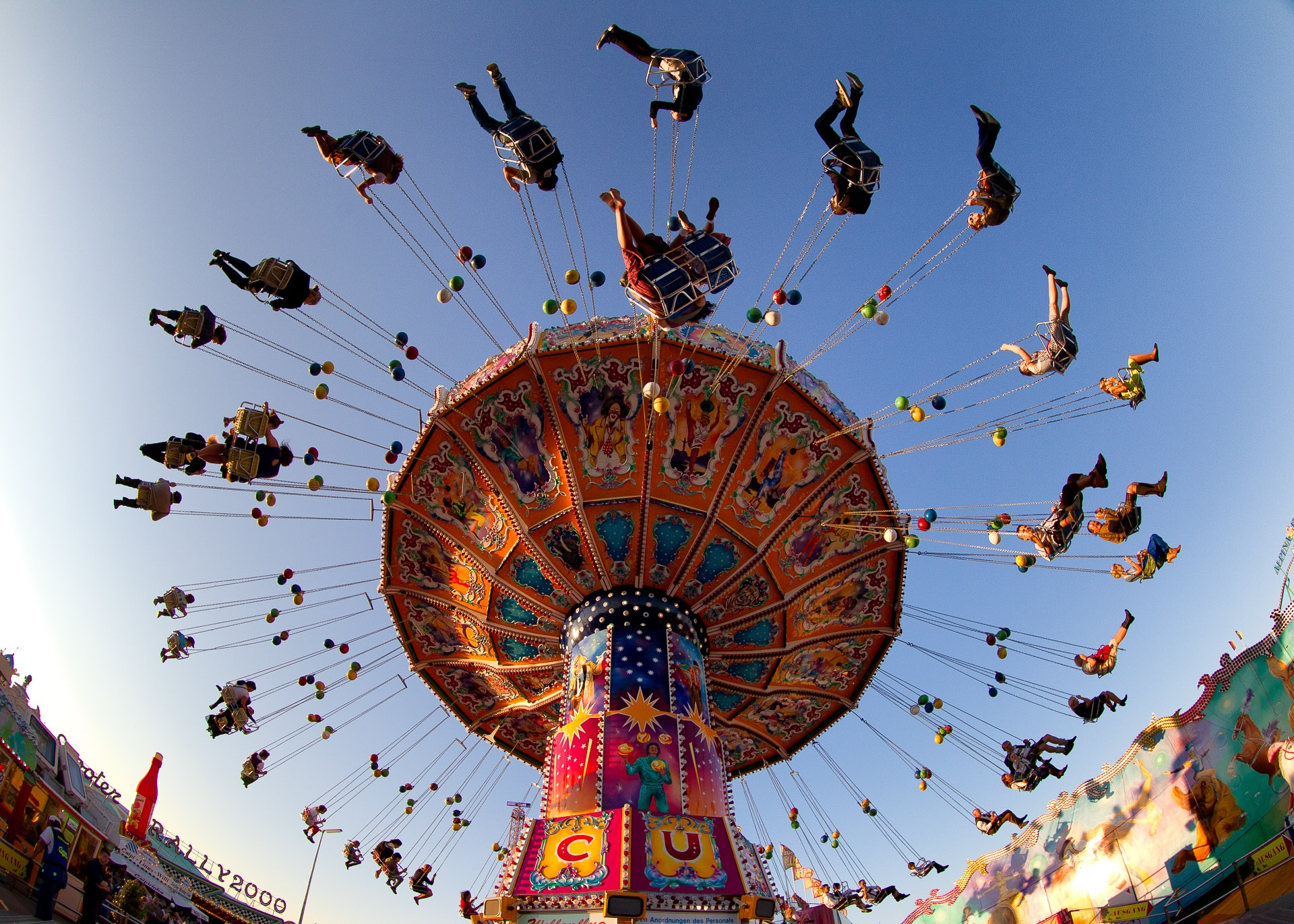 Image: Looking up at people on a carnival ride.