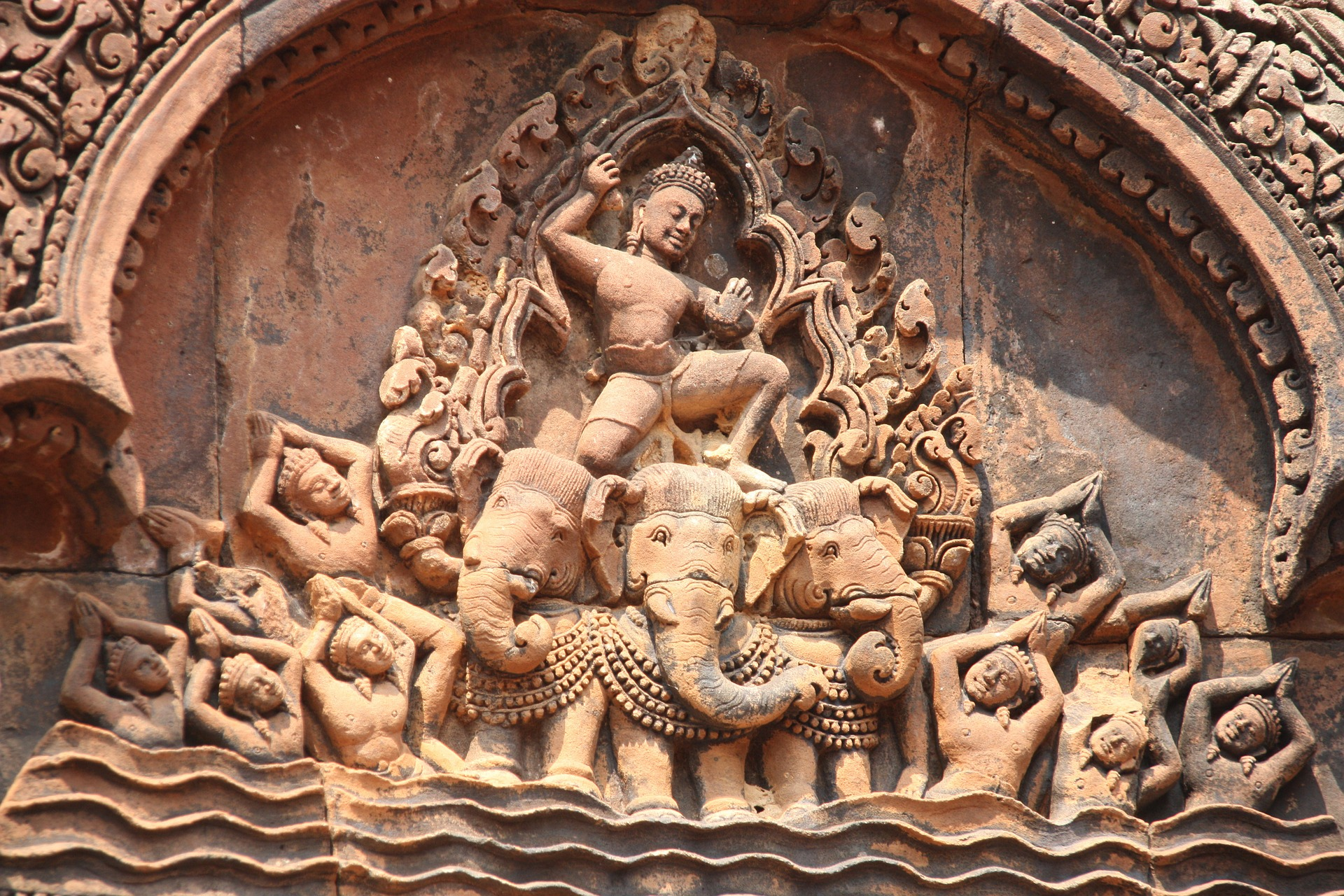 Image: Carving from a Cambodian Temple at Angkor of a deity riding a many headed elephant