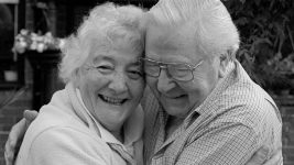 Image: Elderly couple hugging and smiling