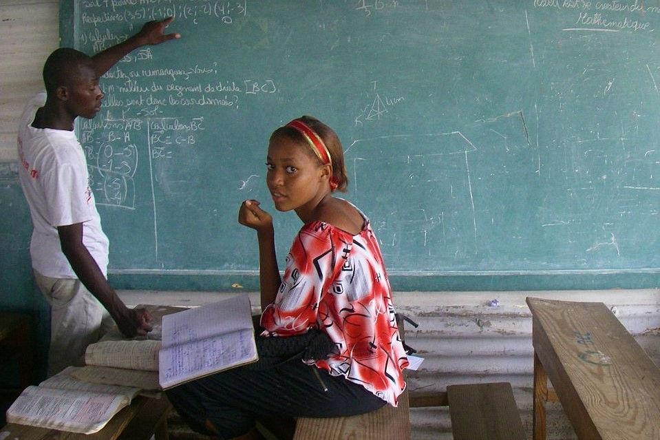 Image: Teenage girl studying in Haiti