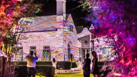Image: art projected on trees and house at Alys Beach. Viewers are taking photos