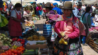Image: Woman in Peru buying food at a market