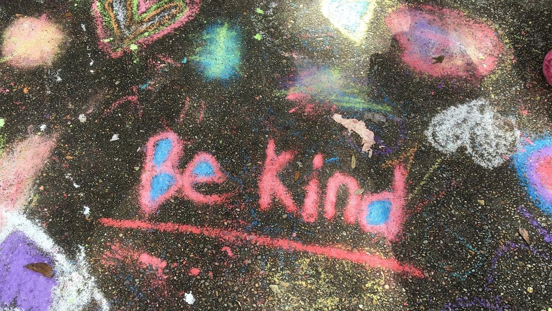 """Image: """"Be Kind"""" written in chalk on a sidewalk"""