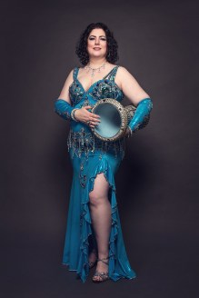 Ashira teal standing with drum