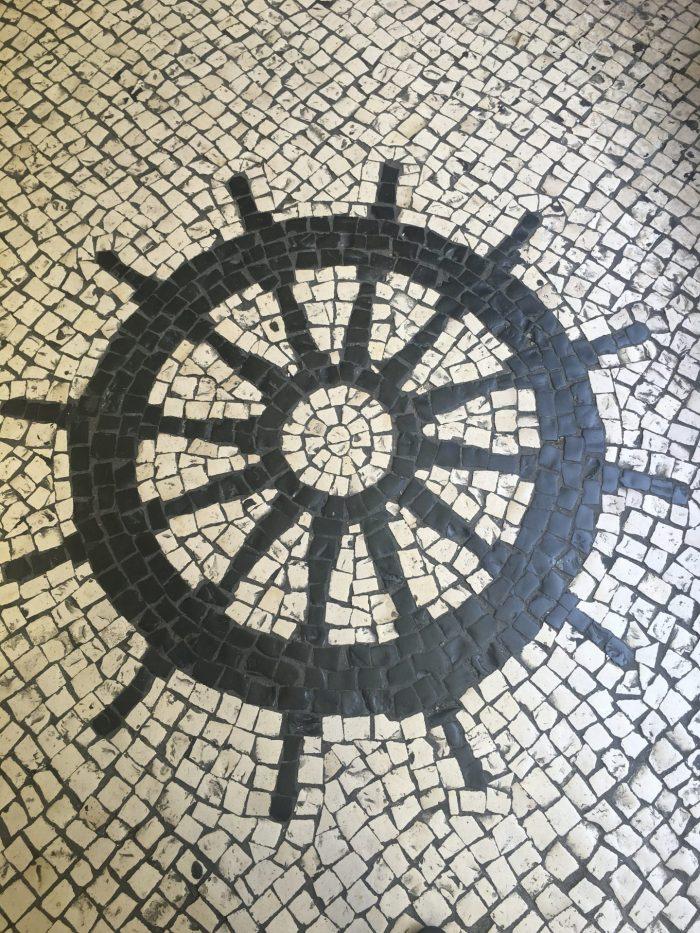 macau tile sidewalk wheel 700x933 - A day trip to Macau from Hong Kong
