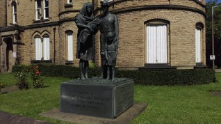 Statue outside the NUM building, always liked it.