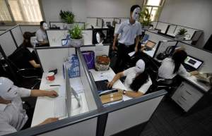 "HANDAN, CHINA - JULY 14:  (CHINA OUT) Staff wear No-Face masks during working hours at a service company on July 14, 2015 in Handan, Hebei Province of China. As a service company, its staffs must smile to customers everyday. On ""No-Face Day"", the staffs wore No-Face masks to reduce pressure and relax themselves. No-Face is a silent masked creature who has no facial expressions in Japanese animated fantasy film ""Spirited Away"".  (Photo by ChinaFotoPress/ChinaFotoPress via Getty Images)"