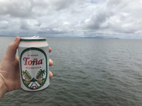 View from the ferry to Ometepe, Nicaragua drinking Toña beer