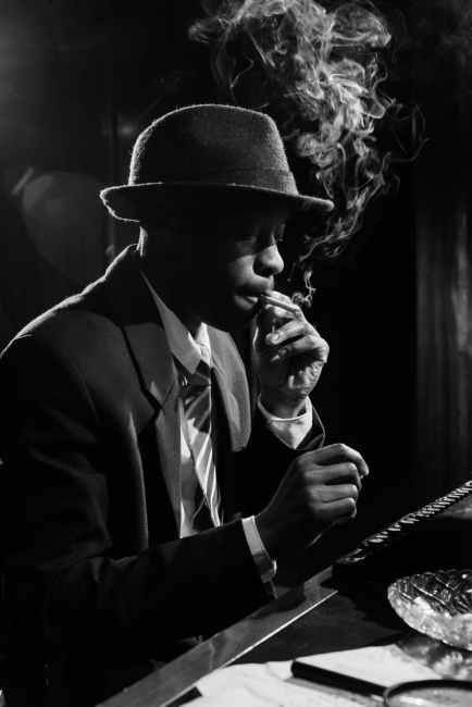side view photo of man smoking cigarette