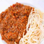 Basic Bolognese Sauce with spaghetti on a white dish
