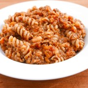 Cowboy dinner - a mince, vegetable and pasta dish with baked beans in a white china bowl.