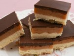 Pieces of millionaires shortbread balanced on top of each other.