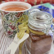 Spiced hot chocolate in a mug with a jar of chocolate mix