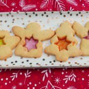 Stained glass biscuits. Angels and Christmas trees with star-shaped windows of orange, red and yellow