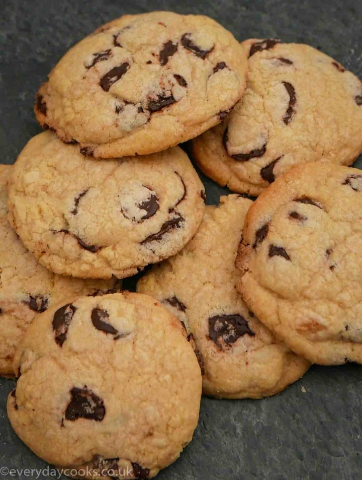 A pile of chocolate polka dot cookies on a slate