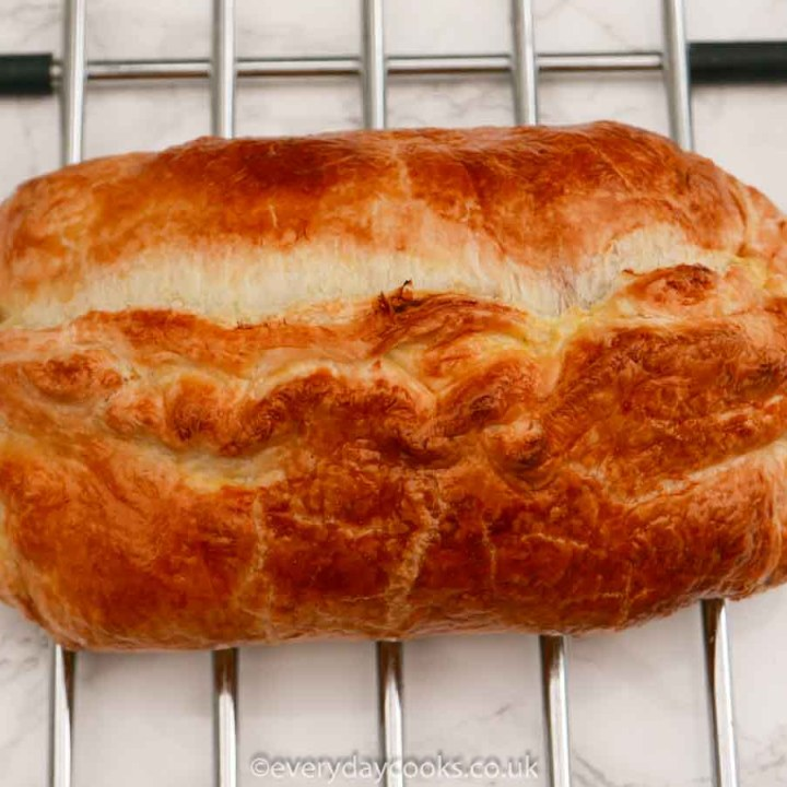 Giant Sausage Roll on a wire rack