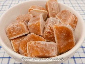 Frozen stock cubes in a white basin