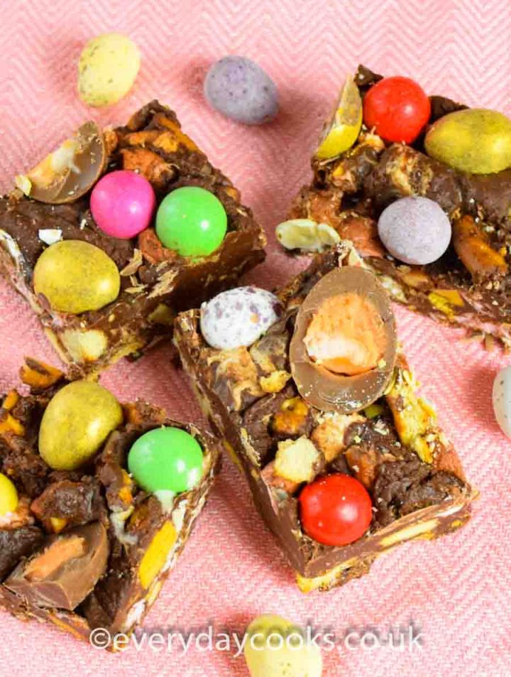 Pieces of Easter Rocky Road on a pink cloth.
