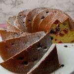Fruit Bundt Cake on a white cake stand