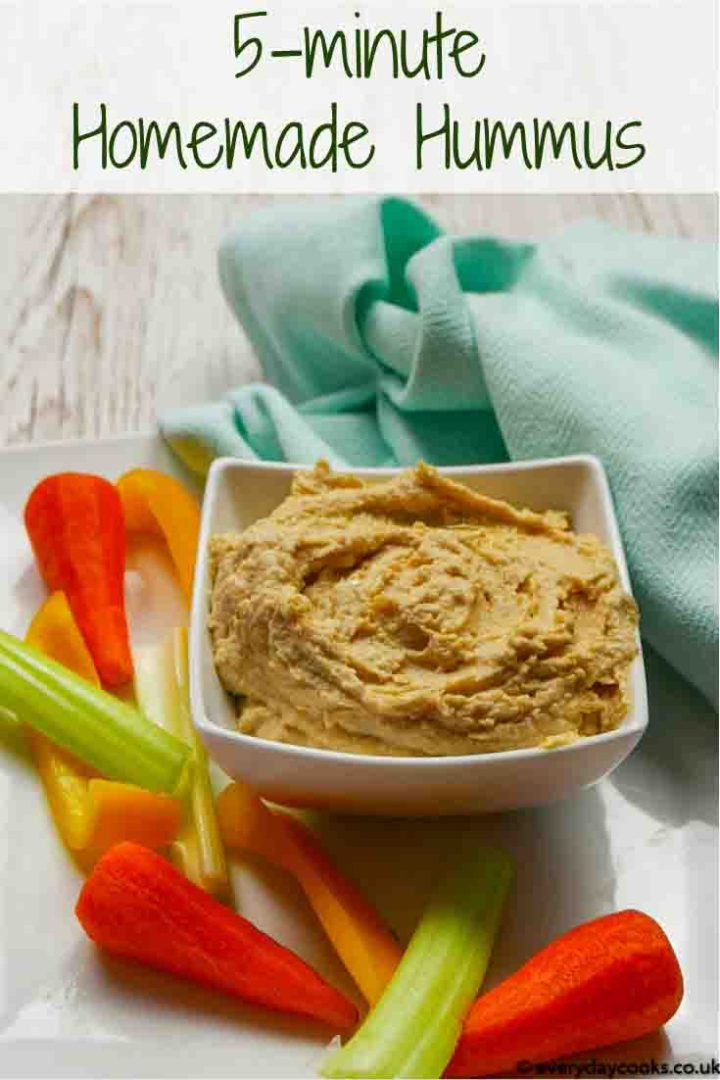 A white dish of Homemade Hummus with raw vegetables