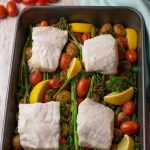 Easy Cod Traybake. Roast vegetables and cod fillets in roasting tin.
