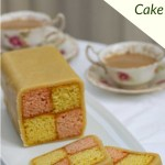 Easy Battenberg Cake on a white plate with 2 slices cut, with 2 cups of tea.