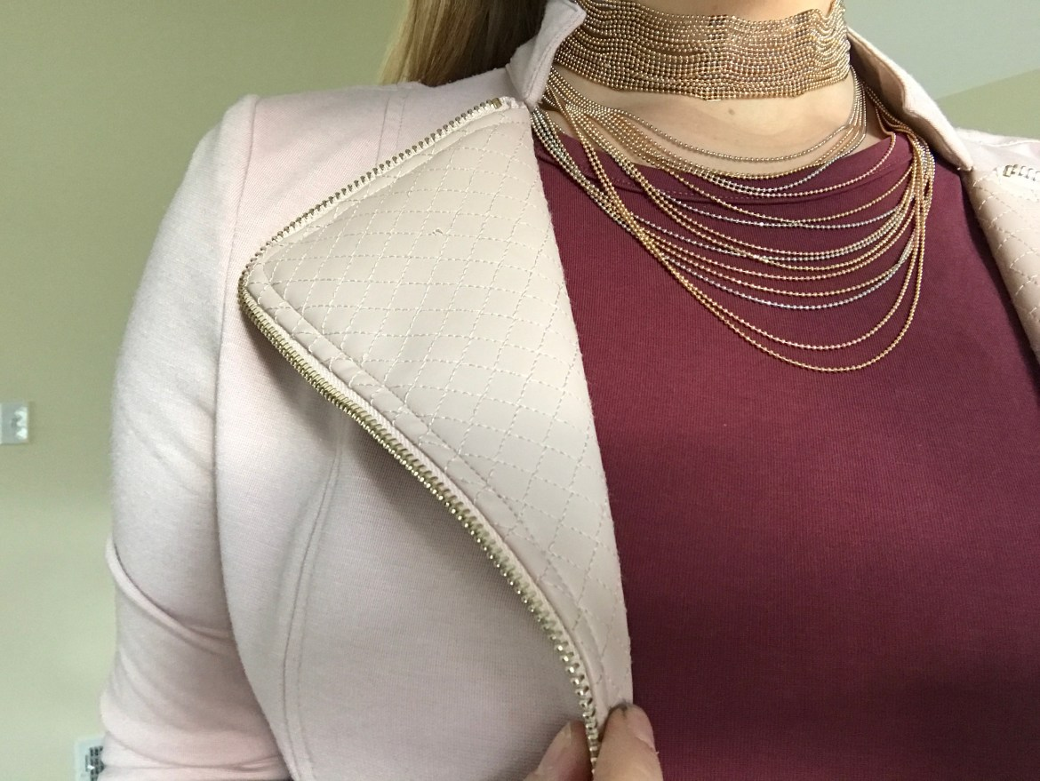 A gold tiered choker that is perfect to wear to Vegas