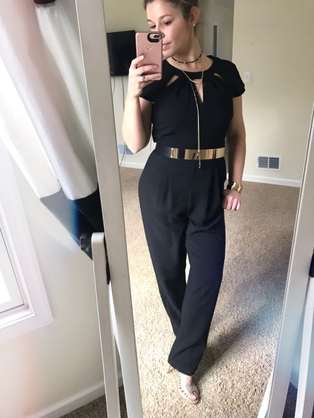 Black jumpsuit with gold belt. A conservative and modest Vegas outfit