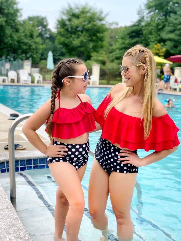 Matching mother-daughter swimsuits - a red top and polka dot bottoms