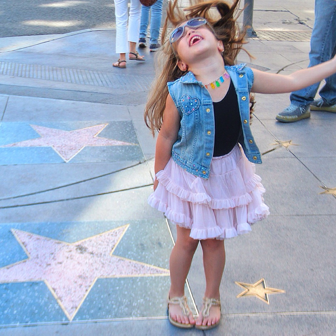 A little girl on the Hollywood walk of fame