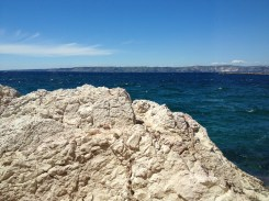 People were sunbathing on these rocks overlooking the Mediterranean.